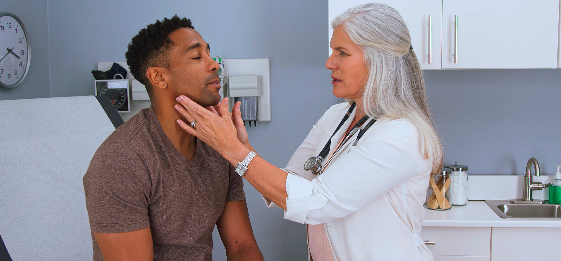 a doctor checking the face of a man